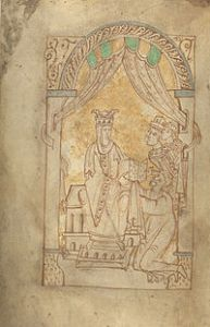 Emma's eleventh-century Encomium (a work that praises) shows Emma with the monk author of the book kneeling and her sons, Harthacnut and Edward the Confessor, beside her. [Credit] © The British Library Board, Add. 33241, f.1v.