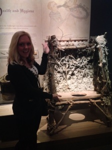 Whitney May by a privy at the Magna Carta exhibit at Houston's Museum of Natural Science