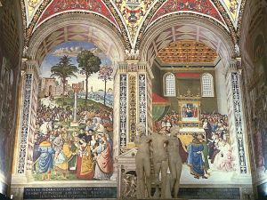 Libreria Piccolomini, Siena, Tuscany, Italy Left : Enea Silvio, Bishop of Siena, presents emperor Frederick III with his future wife. Right : Enea Silvio receives the cardinal's hat In front : The three graces, Roman copy from a Greek original.